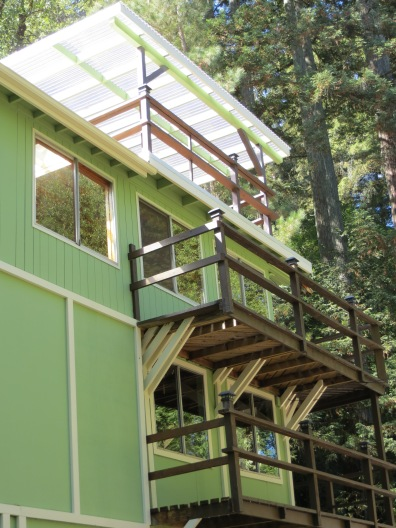 side view- at the very top the upstairs deck off the office