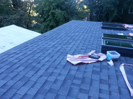 looks pretty much done, put we just placed shingles on the very top to make sure the exposed part of the roof doesn't get wet so we can work right away on Saturday morning