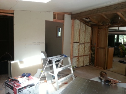 the difference between a wall without drywall on it and one with the drywall hung is amazing