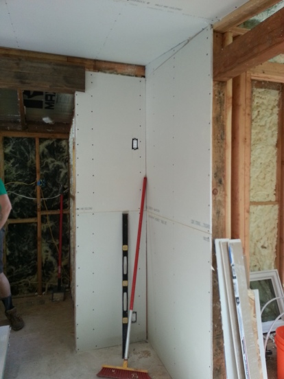 the skinny wall on the left was the most tedious piece I had to hang (an outlet and a notch for the beam had to be incorporated)