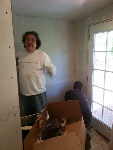 Randy hard at work taping and mudding the laundry room