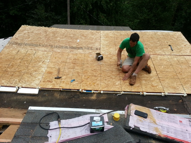 Jacob working on the roof