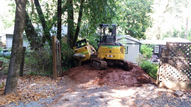 oops! grandpa accidentally ran off the side of Joe's driveway- I had to get in the excavator and drag him out while he steered the bobcat!
